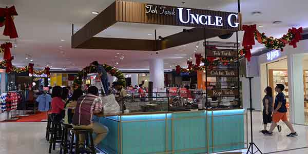 Uncle G shop front in lippo mall puri st. moritz